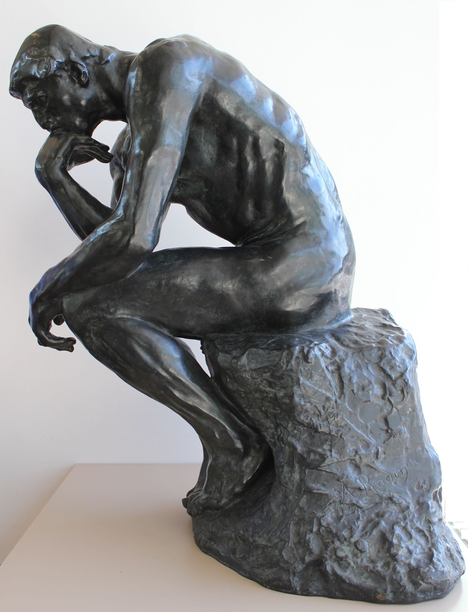 sculpture of thinking man