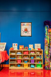create wall for children with play bins